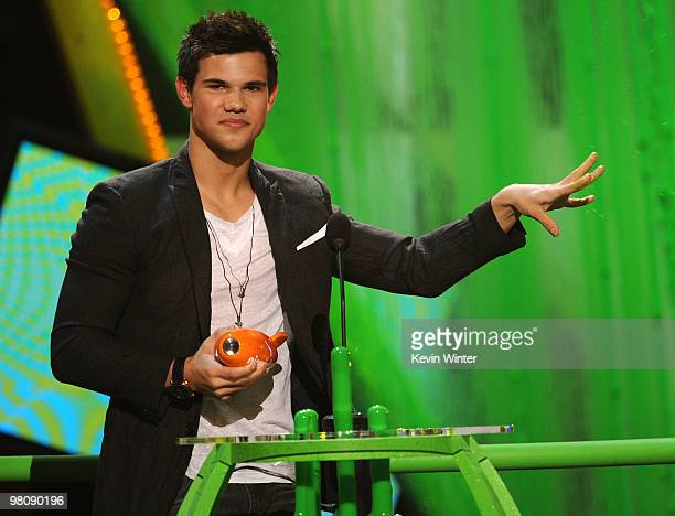 Actor Taylor Lautner accepts the Favorite Movie Actor award onstage at Nickelodeon's 23rd Annual Kids' Choice Awards held at UCLA's Pauley Pavilion...