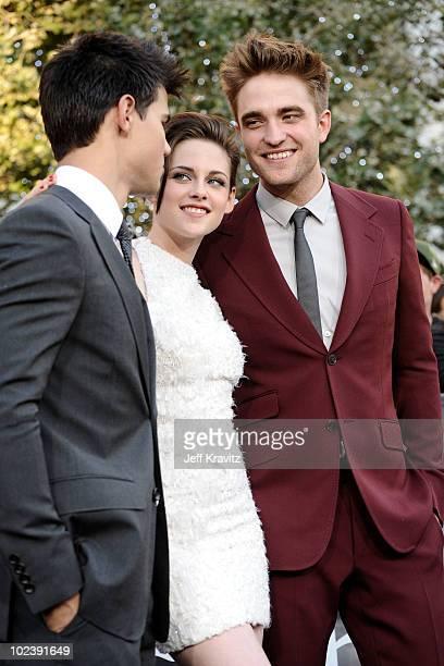 "Actor Taylor Lautner, actress Kristen Stewart and actor Robert Pattinson arrive at the premiere of Summit Entertainment's ""The Twilight Saga:..."
