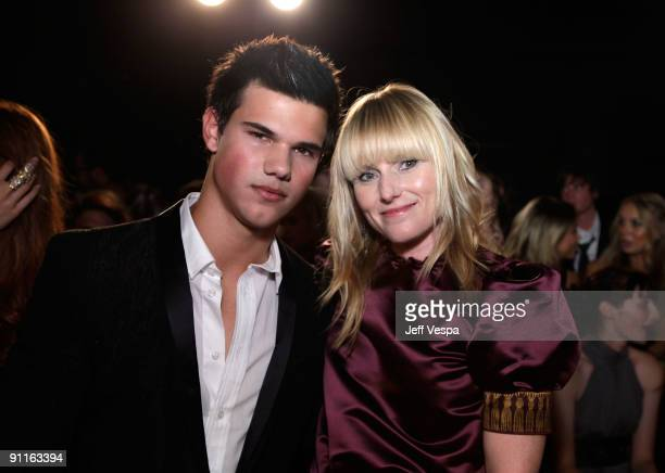 Actor Taylor Lautner and editorinchief Teen Vogue Amy Astley pose during the 7th Annual Teen Vogue Young Hollywood Party held at Milk Studios on...