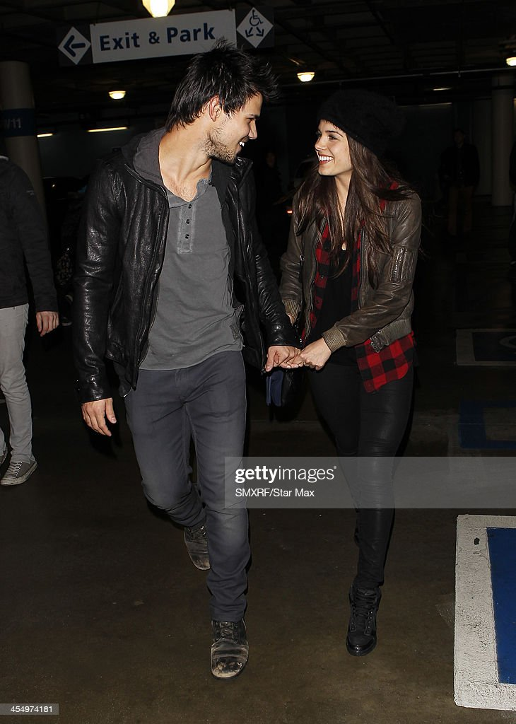 Actor Taylor Lautner and Marie Avgeropoulos are seen on December 09, 2013 in Los Angeles, California.