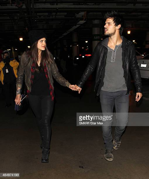 Actor Taylor Lautner and Marie Avgeropoulos are seen on December 09 2013 in Los Angeles California