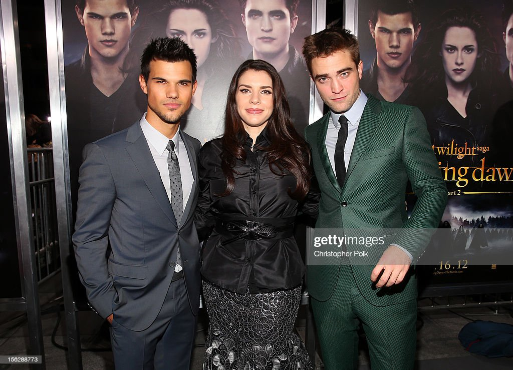 Actor Taylor Lautner, author Stephenie Meyer, and actor Robert Pattinson arrive at the premiere of Summit Entertainment's 'The Twilight Saga: Breaking Dawn - Part 2' at Nokia Theatre L.A. Live on November 12, 2012 in Los Angeles, California.