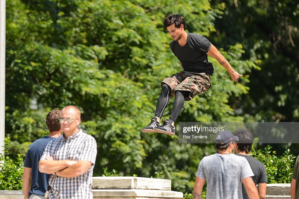 Actor Taylor Lautner rehearses a scene at the 'Tracers' movie set at Riverside Park on June 18, 2013 in New York City.
