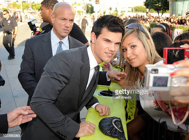 Actor Taylor Lautner signs autographs as he arrives at the premiere of Summit Entertainment's 'The Twilight Saga Eclipse' during the 2010 Los Angeles...