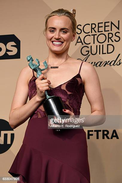 Actor Taylor Schilling winner of the Outstanding Ensemble in a Comedy Series award for 'Orange Is the New Black' poses in the press room during the...