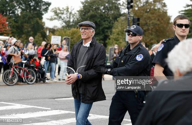 Actor Ted Danson is arrested during the Fire Drill Friday Climate Change Protest on October 25 2019 in Washington DC Protesters demand Immediate...