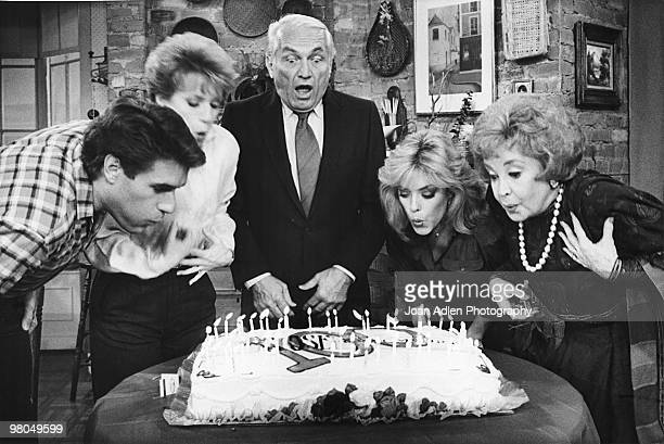 Actor Ted Knight is joined by cast members LR Jim J Bullock Nancy Dussault Lydia Cornell and Audrey Meadows in blowing out the candles on a cake in...