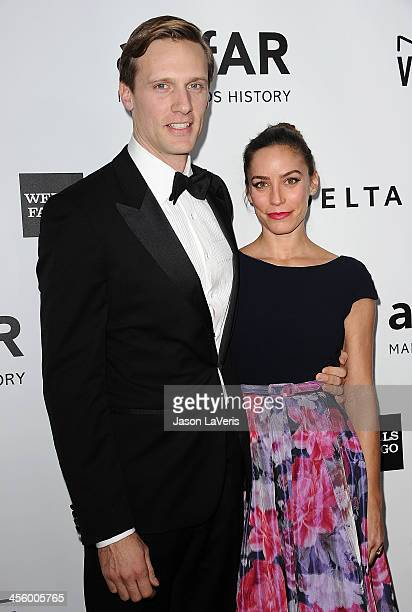 Actor Teddy Sears and wife Melissa Skoro attends the amfAR Inspiration Gala at Milk Studios on December 12 2013 in Hollywood California