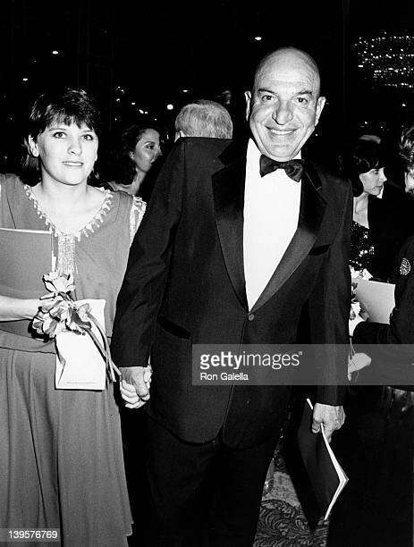 Actor Telly Savalas and wife Julie Hovland attend 13th Annual American Film Institute Lifetime Achievement Awards Honoring Gene Kelly on March 7 1985...