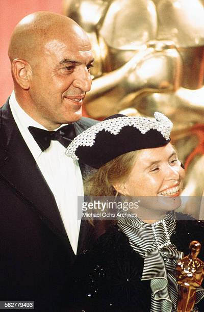 Actor Telly Savalas poses backstage with UllaBritt Soderlund winner of Best Costume Design award during the 48th Academy Awards at Dorothy Chandler...