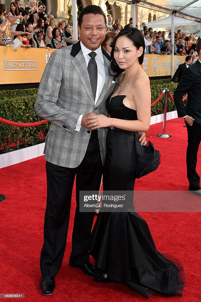 Actor Terrence Howard and guest attend the 20th Annual Screen Actors Guild Awards at The Shrine Auditorium on January 18, 2014 in Los Angeles, California.