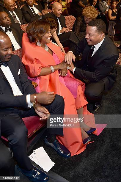 Actor Terrence Howard greets honoree Patti LeBelle at the BET Honors 2016 Show at Warner Theatre on March 5 2016 in Washington DC