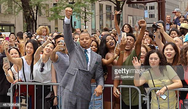 Actor Terrence Howard poses with fans attend the 'Empire' curated collection unveiling at Saks Fifth Avenue on September 12 2015 in New York City