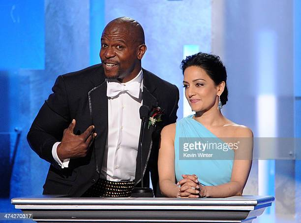 Actor Terry Crews and actress Archie Panjabi speak onstage during the 45th NAACP Image Awards presented by TV One at Pasadena Civic Auditorium on...