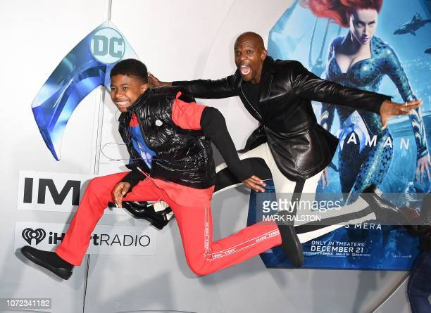 US actor Terry Crews and his son Isaiah Crews arrive for the world premiere of Aquaman at the TCL Chinese theatre in Hollywood on December 12 2018