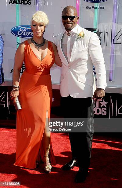 Actor Terry Crews and wife Rebecca Crews arrive at the BET AWARDS 14 at Nokia Theatre LA Live on June 29 2014 in Los Angeles California