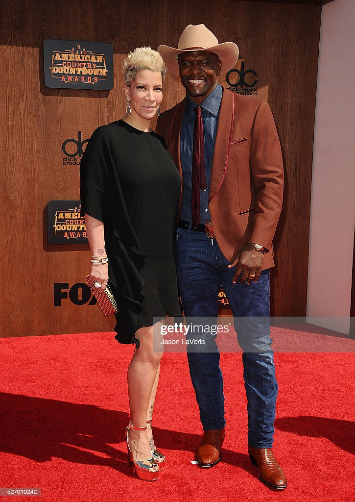 Actor Terry Crews (R) and wife Rebecca King-Crews attend the 2016 American Country Countdown Awards at The Forum on May 01, 2016 in Inglewood, California.
