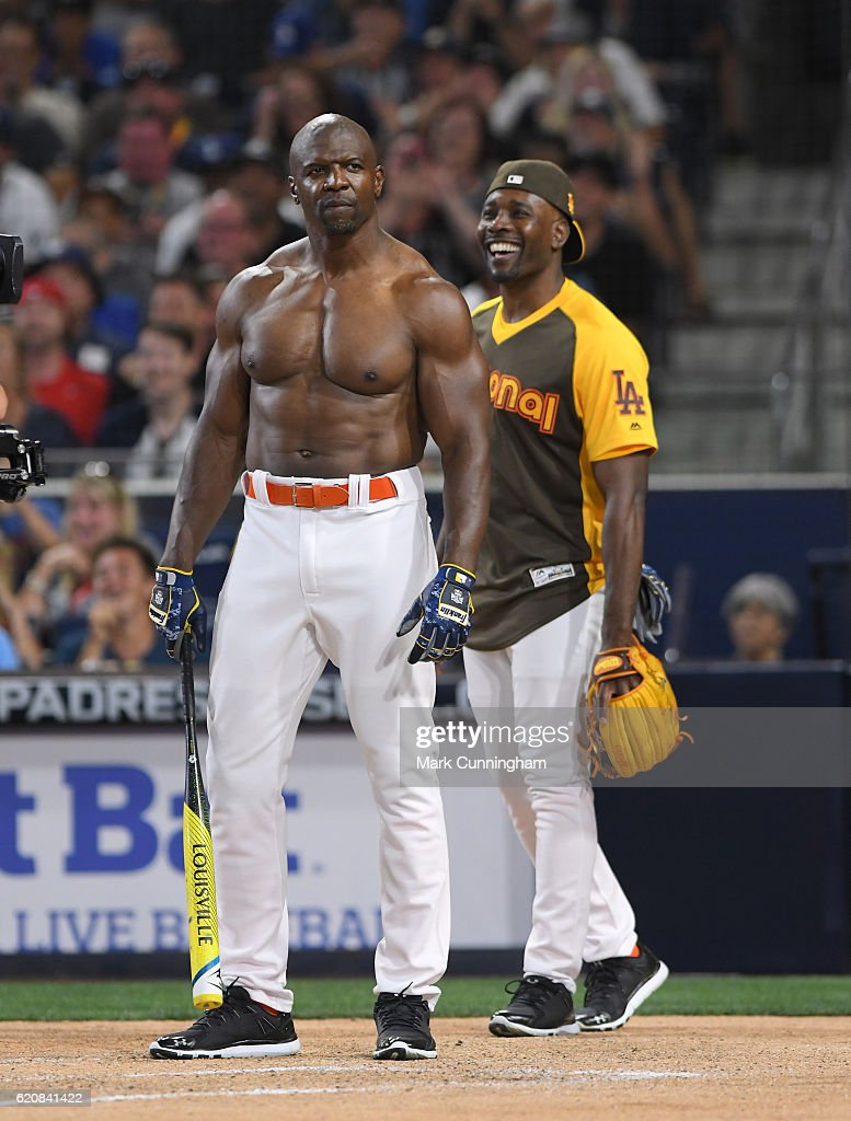 Actor Terry Crews bats while actor Morris Chestnut looks on during the MLB 2016 All-Star Legends and Celebrity Softball Game at PETCO Park on July 10, 2016 in San Diego, California.