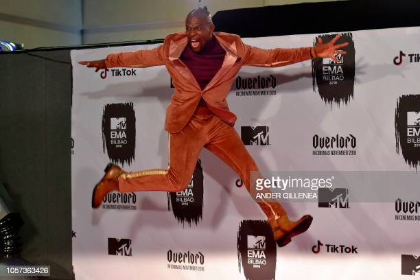 US actor Terry Crews jumps backstage during the MTV Europe Music Awards at the Bizkaia Arena in the northern Spanish city of Bilbao on November 4 2018