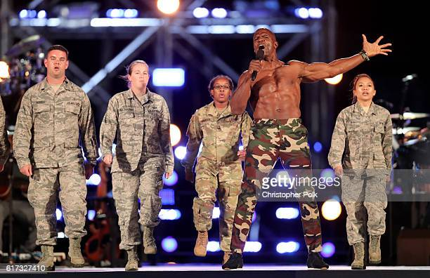Actor Terry Crews performs with service man and women onstage during 'Spike's Rock the Troops' event held at Joint Base Pearl Harbor Hickam on...