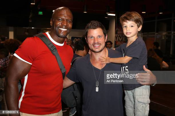 Actor Terry Crews Singer/Reality Star Nick Lachey and son Camden attend the Marvel Universe LIVE Age Of Heroes World Premiere Celebrity Red Carpet...