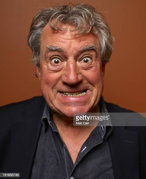 Actor Terry Jones of A Liar's Autobiography The Untrue Story Of Monty Python's Graham Chapman poses at the Guess Portrait Studio during 2012 Toronto...