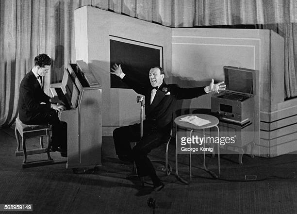 Actor Terry Thomas singing the song 'Mammy' as he mimics singer Al Jolson with musician Derek Scot at the piano circa 1940