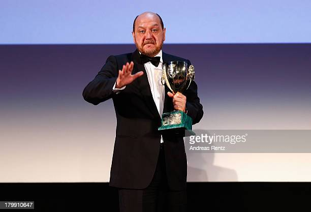 Actor Themis Panou poses with the Best Actor Award he received for his role in the movie 'Miss Violence' at the Closing Ceremony during the 70th...