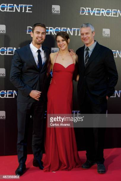 Actor Theo James actress Shailene Woodley and director Neil Burger attend the 'Divergent' premiere at the Callao cinema on April 3 2014 in Madrid...