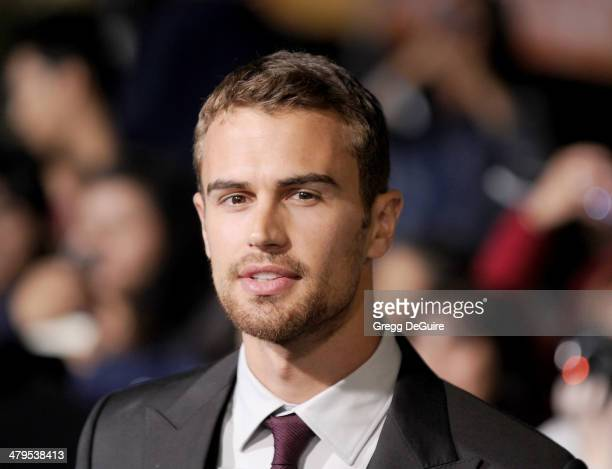 Actor Theo James arrives at the Los Angeles premiere of Divergent at Regency Bruin Theatre on March 18 2014 in Los Angeles California