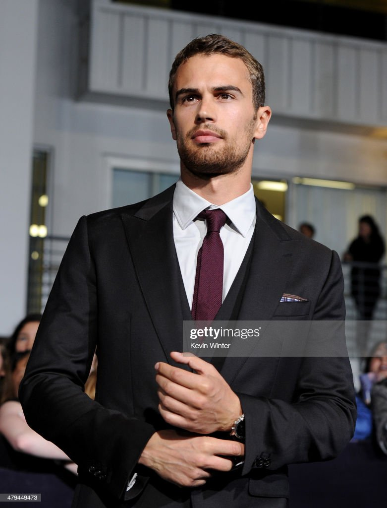 Actor Theo James arrives at the premiere of Summit Entertainment's 'Divergent' at the Regency Bruin Theatre on March 18, 2014 in Los Angeles, California.