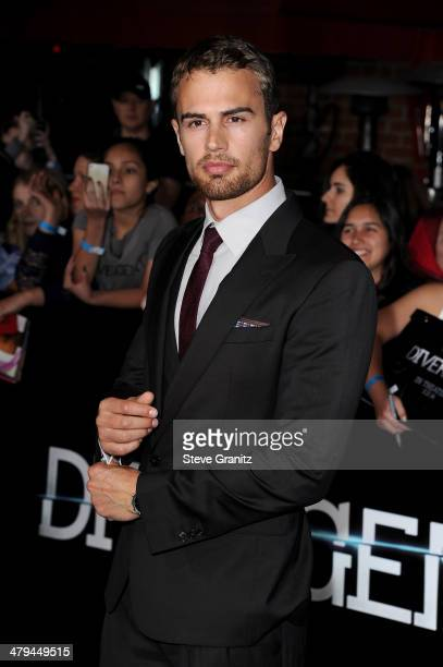 Actor Theo James arrives at the premiere of Summit Entertainment's Divergent at the Regency Bruin Theatre on March 18 2014 in Los Angeles California