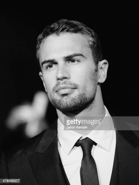 Actor Theo James attends Summit Entertainment's 'Divergent' Premiere at Regency Bruin Theatre on March 18 2014 in Los Angeles California