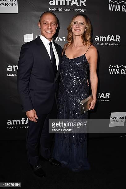 Actor Theo Rossi and Meghan McDermott attend amfAR LA Inspiration Gala honoring Tom Ford at Milk Studios on October 29 2014 in Hollywood California