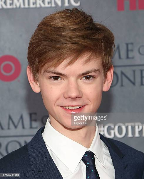 """Actor Thomas Brodie-Sangster attends the """"Game Of Thrones"""" Season 4 premiere at Avery Fisher Hall, Lincoln Center on March 18, 2014 in New York City."""