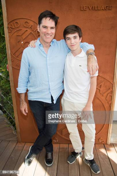 Actor Thomas Gibson and his son Travis Carter Gibson attend the French Tennis Open 2017 Day Thirteen at Roland Garros on June 9 2017 in Paris France