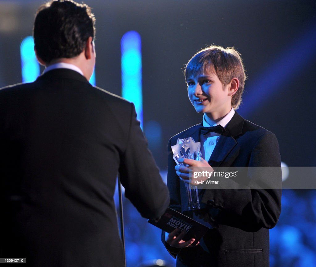 Actor Thomas Horn (R) accepts the Best Young Actor/Actress award for 'Extremely Loud and Incredibly Close' from actor Paul Rudd onstage during the 17th Annual Critics' Choice Movie Awards held at The Hollywood Palladium on January 12, 2012 in Los Angeles, California.