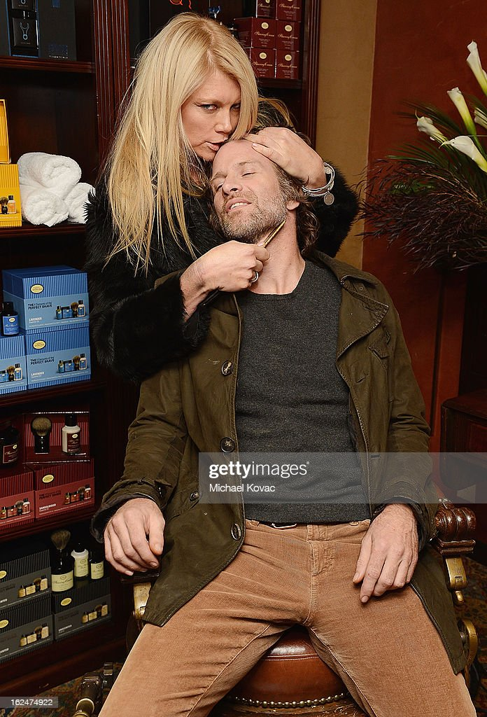 Actor Thomas Jane and actress Peta Wilson pose for a photo at the The Art of Shaving And Bungalow 8 Pre-Oscar Party at Petit Ermitage Hotel on February 20, 2013 in West Hollywood, California.