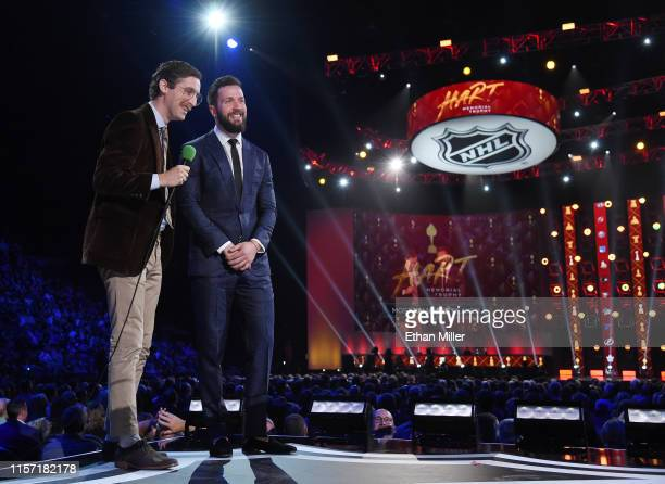 Actor Thomas Middleditch playing the character of NHL hockey commentator Tony Babcock talks with Nikita Kucherov of the Tampa Bay Lightning during...