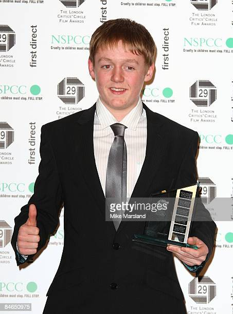 Actor Thomas Turgoose holds his NSPCC award young British performer of the year at The 29th Annual London Critics' Circle Film Awards at Grosvenor...