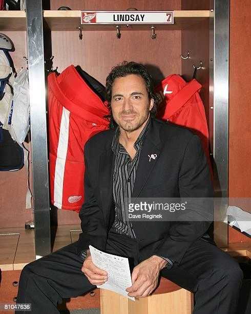 Actor Thorsten Kaye of ABC daytime drama All My Children poses for a photo in front of the NHL Hall of Fame locker Ted Lindsey during his tour of the...