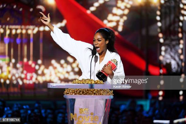 Actor Tiffany Haddish accepts the Best Comedic Performance award for 'Girls Trip' onstage during the 2018 MTV Movie And TV Awards at Barker Hangar on...