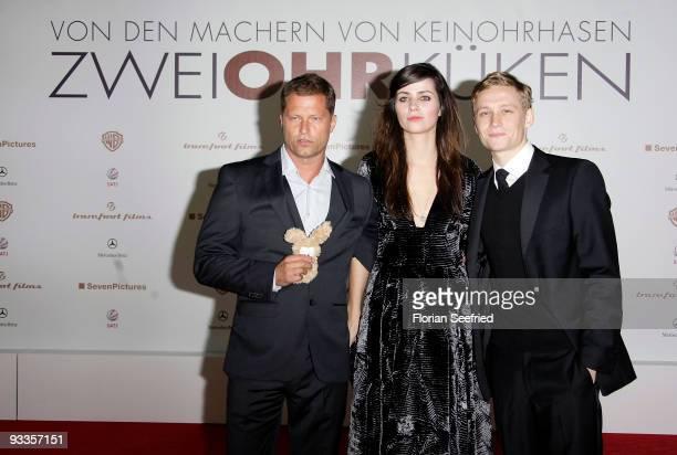 Actor Til Schweiger actress Nora Tschirner and actor Matthias Schweighoefer attend the premiere of 'Zweiohrkueken' at the Sony Center CineStar on...