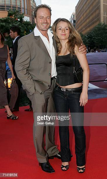 """Actor Till Demtroeder and his daughter Valerie arrive at the German premiere of """"Poseidon"""" July 11, 2006 at the Berlinale Palast in Berlin, Germany."""