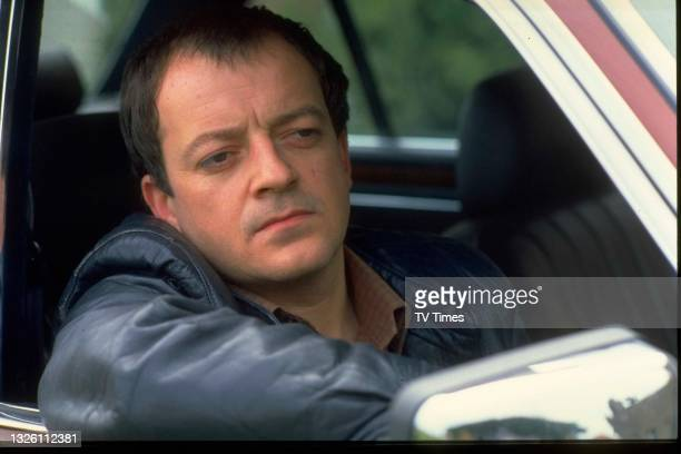 Actor Tim Healy in character as Dennis Patterson in comedy drama Auf Wiedersehen, Pet, circa 1986.