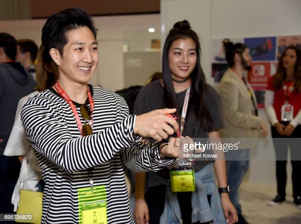 Actor Tim Jo and Model Hannah Jun visit the Nintendo booth at the 2017 E3 Gaming Convention at Los Angeles Convention Center on June 13 2017 in Los...
