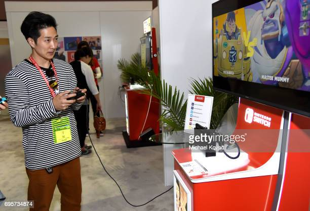 Actor Tim Jo plays ARMS at the Nintendo booth at the 2017 E3 Gaming Convention at Los Angeles Convention Center on June 13 2017 in Los Angeles...