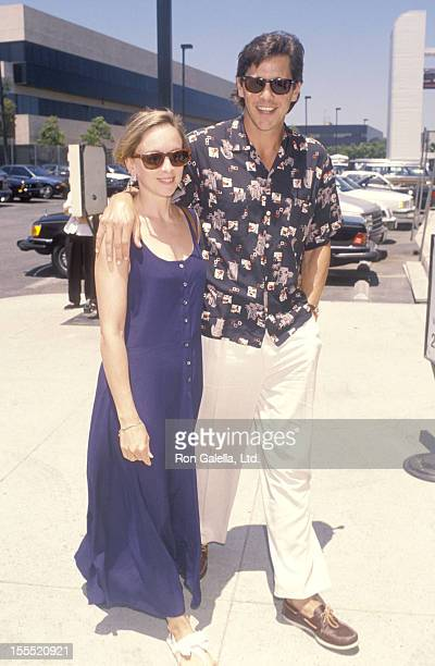 Actor Tim Matheson and wife Megan Murphy Matheson on June 23 1990 arrive at the Los Angeles International Airport in Los Angeles California