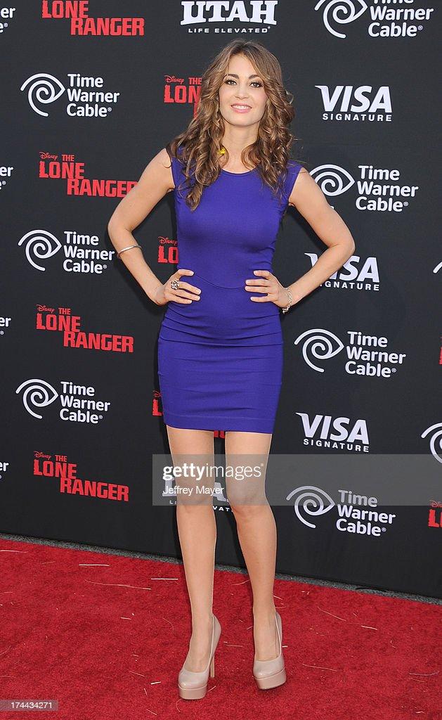 Model Tanit Phoenix arrives at 'The Lone Ranger' World Premiere at Disney's California Adventure on June 22, 2013 in Anaheim, California.ANAHEIM, CA- JUNE 22: Actor Tim Murphy arrives at 'The Lone Ranger' World Premiere at Disney's California Adventure on June 22, 2013 in Anaheim, California.