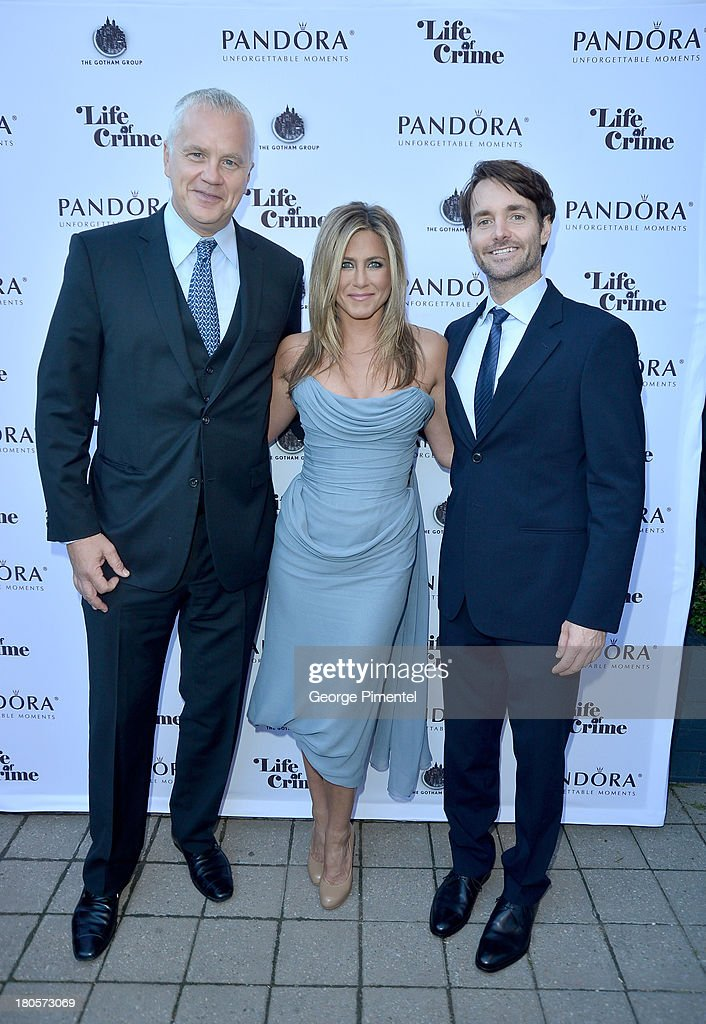 Actor Tim Robbins, actress/Producer Jennifer Aniston (wearing Vivienne Westwood gown) and actor Will Forte attend the 'Life of Crime' cocktail reception presented by PANDORA Jewelry at Hudson Kitchen during the 2013 Toronto International Film Festival on September 14, 2013 in Toronto, Canada.